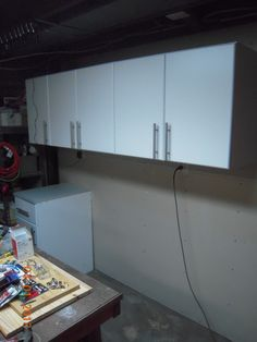 Step 3) Base cabinets are being installed below the wall mounted cabinets