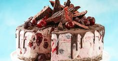 Cherry Ripe ice-cream cake This spectacular ice-cream dessert featuring chocolate, strawberries and Cherry Ripe only takes 20 minutes to prepare. Christmas Ice Cream Cake, Frozen Christmas, Christmas Lunch, Christmas Cooking, Christmas Desserts, Christmas Parties, Christmas Treats, Christmas Cakes, Aussie Christmas