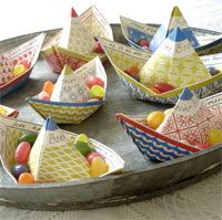Paper boats to some how use with raingutter regatta....