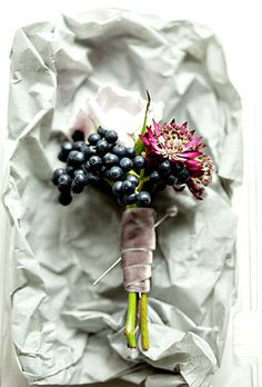 Brides.com: . Wedding boutonniere of scabiosa, viburnum berries, and astrantia by Sullivan Owen Floral & Event Design Browse more wedding boutonnieres.