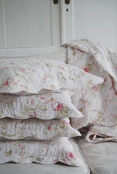 ~ pretty, soft pink, rose and white quilted shams and quilts...perfect for a feminine bedroom