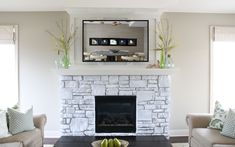 Nereus mirror tv in place above fireplace in lounge