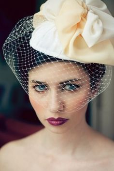 If you don't look like you're going to the races, I don't see what good a wedding hat does.