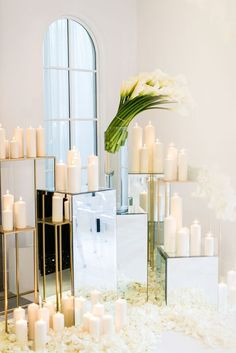 The chuppah was framed by mirrored and gold pedestals holding pillar candles and modern bouquets of calla lilies.| Orchid Wonderland | White Lilac Inc. | Event Design for Weddings, Fashion, Social, Corporate