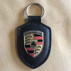 Porsche key fob Porsche Key Fob, great condition, used a handful of times. Black leather with authentic Porsche design.