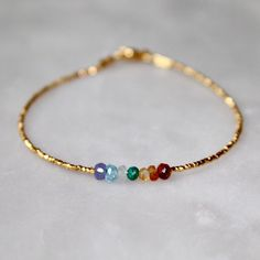 A gorgeous custom order chakra bracelet with a row of 7 different gemstones for someone that was inspired by the Spiritual Watermelon Tourmaline Bracelet. I just love working with people to design custom orders! Simple Bracelets, Simple Jewelry, Cute Jewelry, Jewelry Crafts, Beaded Jewelry, Jewelry Bracelets, Jewelry Accessories, Jewelry Design, Beaded Necklace