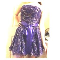 Jessica McClintock Homecoming Dress Very beautiful homecoming dress. Tulle bottom that is not itchy. Feels quality. Purple dress with gold accent. Structured top. Purple satin bow accent. Jessica McClintock Dresses