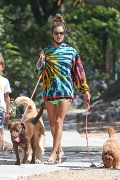 Alessandra Ambrosio wearing a tie-dye sweatshirt with short shorts and thong sandals while walking three dogs in Los Angeles, July 14. #alessandraambrosio #tiedye #summeroutfits #shortsoutfit Neon Green Shorts, Old Shows, July 14, Brazilian Models, Tie Dye Sweatshirt, Denim Cutoffs, Alessandra Ambrosio, Women's Sandals, Short Shorts