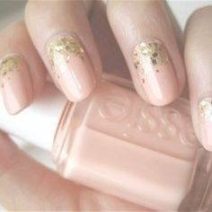 To create this look- don't go crazy with the sparkle just add a subtle sparkle. Only paint gold specs one third of the way up the nail.