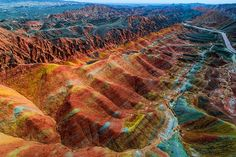 Aerial view on the colorful rainbow mountains of Zhangye danxia landform geological park in Gansu province, China, May (Photo by Photons_in_action/Getty Images) Top Travel Destinations, Best Places To Travel, Cool Places To Visit, Places To Go, Rainbow Mountains, Colorful Mountains, Best Vacation Spots, Best Vacations, Zhangye Danxia Landform