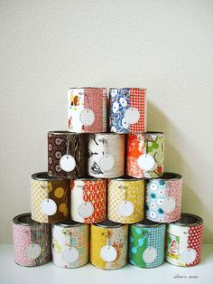 You can buy empty paint cans at Sherwin Williams. spruce them up to use for organization! I need to do this!!