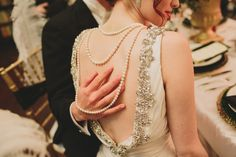 Back drape necklace   From The Mag: Wedding Pearls Look polished on your special day with a strand of pearly whites