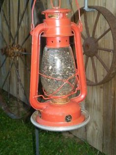 This is an old lantern repurposed (or upcycled) into a bird feeder...how cool!