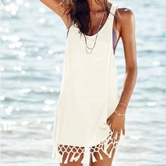 NWOT Coral VS Tunic Cover up New without tags, Victoria Secret swim suit tunic cover up with tassels. Pictured in white but listing is for coral. Victoria's Secret Swim Coverups