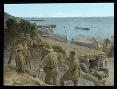 WWI, 1915; At Anzac Cove. Hand-coloured glass slide shows British soldiers near a dugout at ANZAC Cove. Gallipoli, 1915. Credits: Alan Anderson-Compiler. Source: National Film and Sound Archive of Australia.