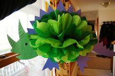 Dinosaur Pom-pon {image only, but this would be a neat addition in the dinosaur theme classroom!}