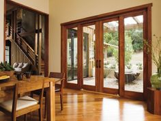 This wood patio door set from pella is an elegant twist on the pella 4 panel sliding glass door homeowners enjoy creating basic illusions in their homes closet doors are fantastic pro planetlyrics Choice Image