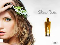 """Create gorgeous soft curls with L'Oréal Paris Extraordinary Oil. Apply a few drops after washing, wrap your head in a towel, then lightly squeeze without rubbing the hair inside. Perform the action starting at the tips and finishing at the roots. Remove towel and reveal curls that are more beautiful and well-defined. Like and share this tip if you want to be the """"mane"""" attraction of any party!"""