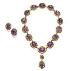 GOLD AND AMETHYST NECKLACE AND EARCLIPS The necklace and earclips set with 18 round, oval and pear-shaped amethysts weighing approximately 110.00 carats, within gold scrollwork surrounds, necklace length 14½ inches; mid-19th century.