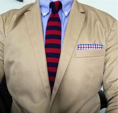 Beige jacket, blue gingham shirt, red & navy striped knit tie
