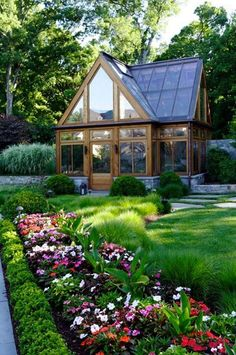 If you like gardening you might love your own backyard greenhouse like this one!