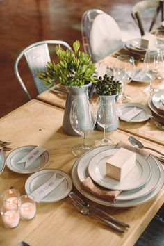 Rustic table setting. Green flowers. Burlap napkins. Jug centerpieces.
