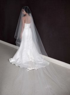 Beautiful cathedral length drop veil with raw cut edge. Veil length of 110 and width of 108. Blusher length of 50. Made of soft bridal