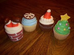 I saw the Santa in the Chimney cupcakes online and had to try them myself.  But I didn't like how they peeled off the paper and piped the brick onto the actual cupcake.  So I printed out a brick pattern on my computer and wrapped it around the cupcake. All are iced in BC with MMF decorations.