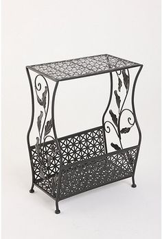 Darling side table...would even be good as a night stand with room for your books underneath.