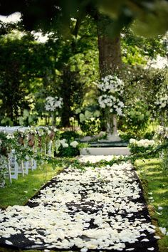 pretty ceremony decor for a wedding in the woods