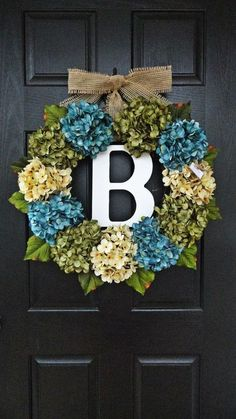 Front door wreath - personalized.  I need to do this and put all my fake flowers to | http://my-christmas-decor-styles.blogspot.com