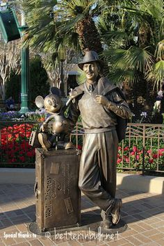 "Storyteller Statue on Buena Vista Street in DCA | Not far away from the Carthay Circle Theater is the ""Storyteller"" statue of Walt & Mickey which represents Walt during the studio years. The statue stands on the ground & is life size. Walk right up to him & take your picture w/ him. 