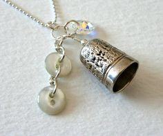 Sterling silver crystal and vintage mother of pearl button and thimble charm necklace, by me on Etsy.