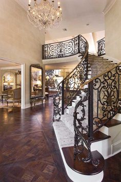 Love the wrought iron design of this staircase and the details, finishing in this house.