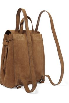 Light-brown suede (Cow) Magnetic-fastening front flap, drawstring top Designer color: Sienna Imported