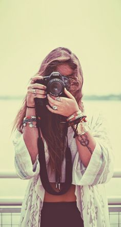 boho, feathers + gypsy spirit. Love this, minus the fact that she has no idea how to properly/safely hold a camera...