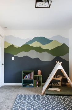 Want to learn how to paint a mountain mural your bedroom? You're going to love this tutorial featuring Behr Paint's 2020 Color Trends and Color of the Year. #playroom #mountain #mural #walldecor #paint
