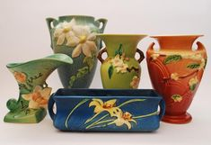 ROSEVILLE POTTERY: MAGNOLIA, CLEMATIS, APPLE BLOSSOM, SNOWBERRY, AND ZEPHYR LILY DESIGNS.