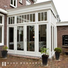 sunroom on house with brick siding House Extension Design, House Design, Brick Siding, Villa, Outside Living, House Extensions, Glass House, Porches, House Rooms