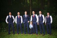 Rustic Tennessee Wedding by Justin Wright Photography  http://lovetoastblog.com/2013/10/30/tennessee-wedding-justin-wright-photography/  Groomsmen in blue vests and pink and red ties to match the bridesmaids. Groom in full suit.