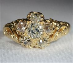 Antique Victorian Diamond Cluster Ring with Floral Carved Shoulders
