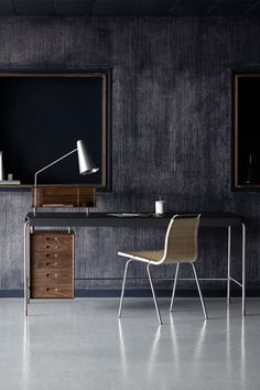 A timeless example of the Danish architect's functionalist approach to design, Arne Jacobsen's AJ52 Society Table was conceived in 1952, at the peak of his career. Jacobsen harnessed new techniques and materials to create the slender writing desk, which features a fine-structured leather top that wraps tightly around a tubular metal frame.