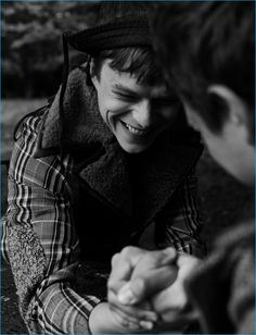 Dane DeHaan arm wrestles with Ansel Elgort for the pages of L