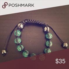 Adjustable crystal bracelet Bracelet adjusts to any wrist size - new but don't recall brand - comes with drawstring pouch Jewelry Bracelets