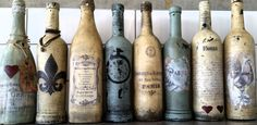 Wine bottles painted in Chalk Paint (tm) and decoupaged.