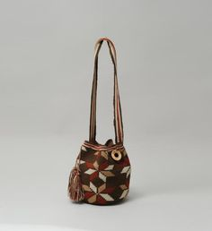 """100% Handmade in Colombia, Indigenous Latin-American Designed, Woven Using Century-Long Techniques, Every Bag Has Its Unique Pattern and Details Wooden Numbered Ring on Every Bag Guarantees its Authenticity *14""""W x 12""""H x 9""""Gusset *Strap Drop: 18"""""""