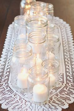 Such a pretty and inexpensive Thanksgiving Centerpiece. Empty food jars with white candles. Love it!