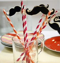 now this is a fun party!  What you'll need to re-create:  Moustache Rub-ons   Paper Striped Straws   Light Colored or Clear Overlays (I used Grandmas Wallpaper)   Staples/Stapler   Glue Dots or other adhesive