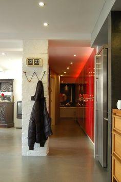 view of laundry room hallway to bedroom hallway
