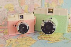 Pair of Diana F+ Lomography Cameras.  Evelyn and Dreamer. Pastel Cameras.  Toy Camera, Lomography Camera, Urban Outfitters Camera on map of New York.